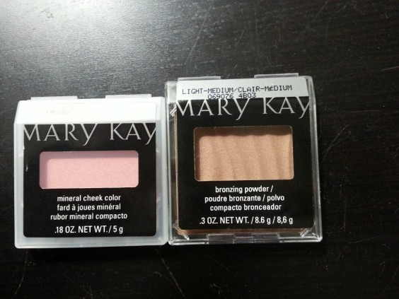 This is the Mary Kay Mineral Cheek Color in Shy Blush and the Mary Kay Bronzing Powder. These two products go hand in hand with one another. These by far are my favorite products from the box. Together they remind me of Nars Laguna Bronzer and blush set. They are very pigmented and are perfect for a pretty flush pink and sun-kissed contour.
